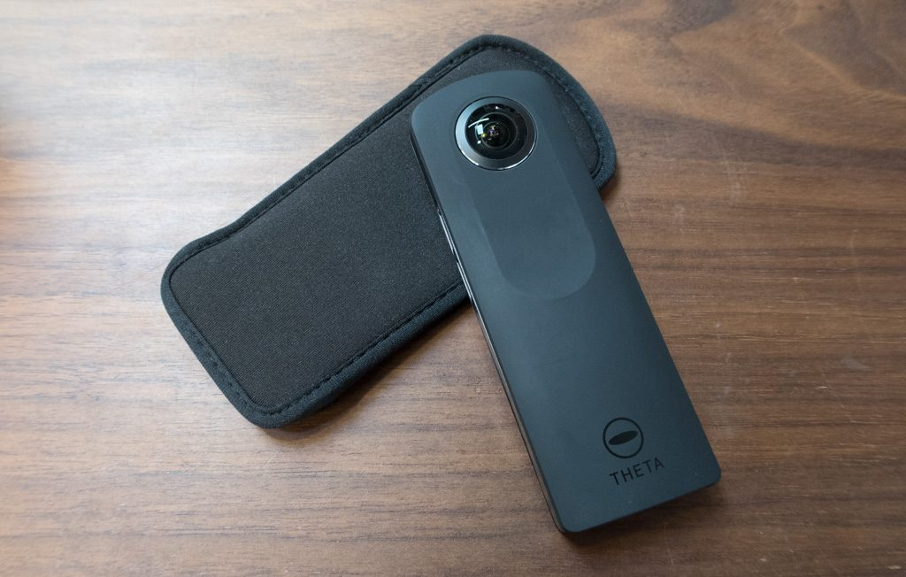 Theta S camera with its included neoprene pouch